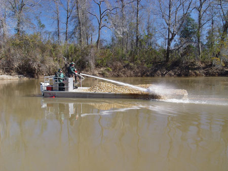 using pump to put gravel in river